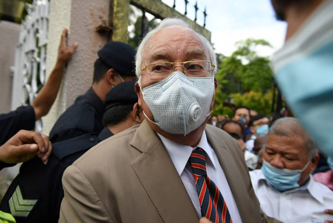 Former Malaysian premier sentenced to 12 years in jail